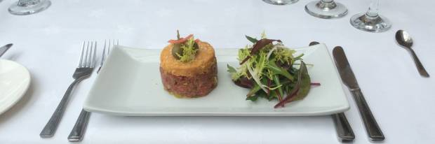 Tartare of pan-fried Beef, Parmesan Crumble, Baby Spinach Salad.